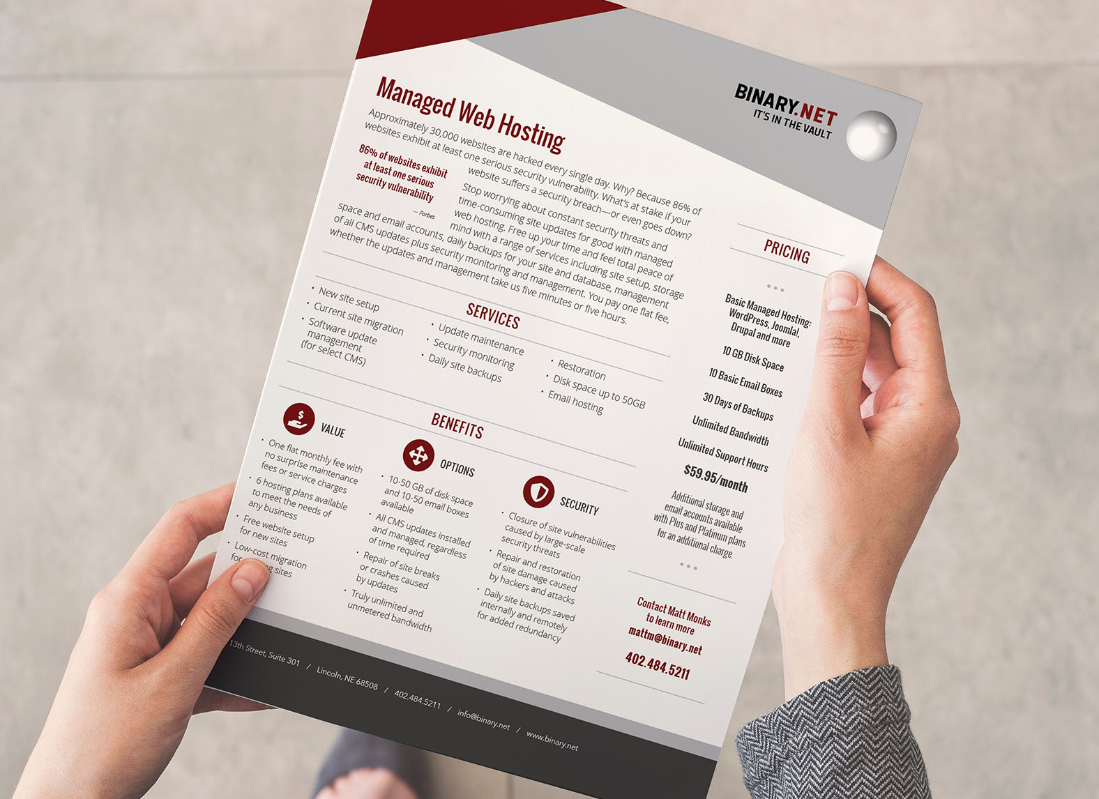 person holding one sheet infographic sell sheet for tech company