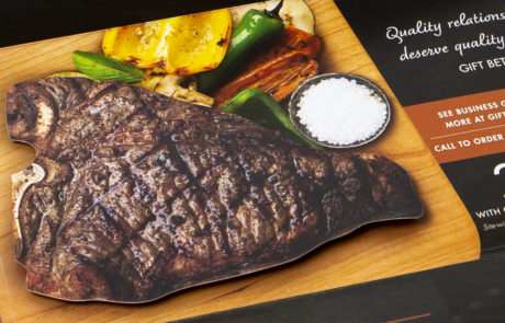 Popup business to business mailer with diecut steak on riser to add dimension